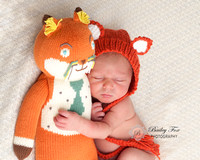 newborn baby photography taken with fox prop