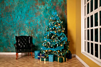 Green New Year tree decorated with toys and balls. Christmas background with grunge plaster wall