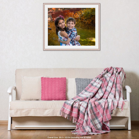 fall family portrait on a wall over a couch
