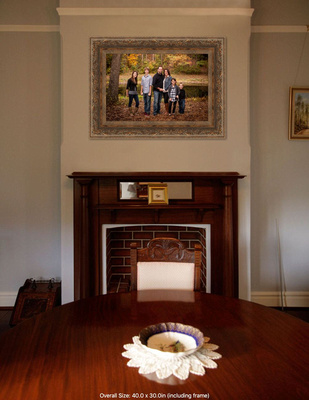 This image is of a faire place  with a 30x40 framed and matted fall family portrait over it