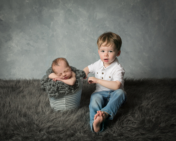 another composite shot of an infant baby boy with his big brother who was less than happy to be near him!