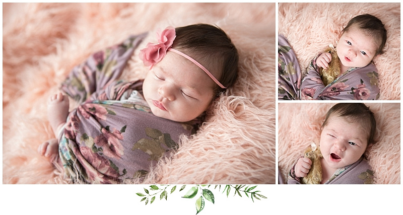 baby girl in floral wrap on pink backdrop