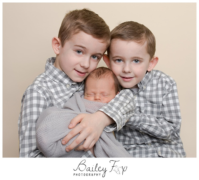 family and sibling newborn portrait newborn baby with his 2 older brothers
